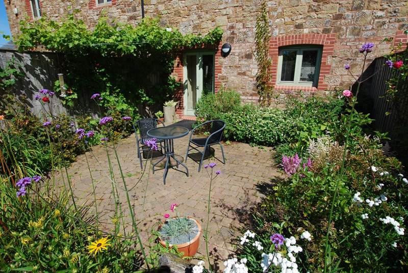 The delightful private garden at the back of Ostler's Cottage.