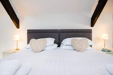 Lovely crisp white linen adorns the bed.