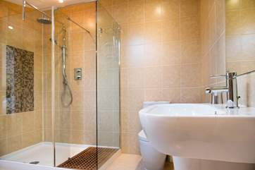 The en suite is simply stunning and the walk in shower has a drench shower head.