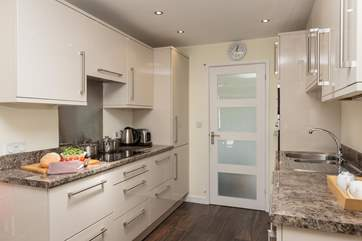 There is an exceptionally well-equipped kitchen off the living area, with everything you could  need for your stay here.