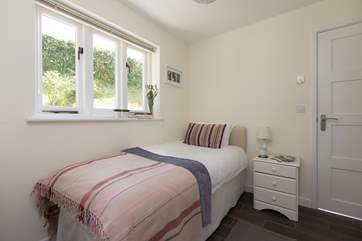 The pretty single bedroom is at the back of the Studio with its own access as well through this door - leading to the cloakroom -  as well as to the wet-room.