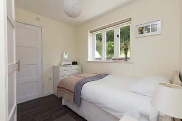 Another view of the single bedroom, which also has plenty of storage space along one length of it.