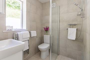 The wet-room style shower which also has a door to the single bedroom for convenience and flexibility - there is a separate cloakroom too.