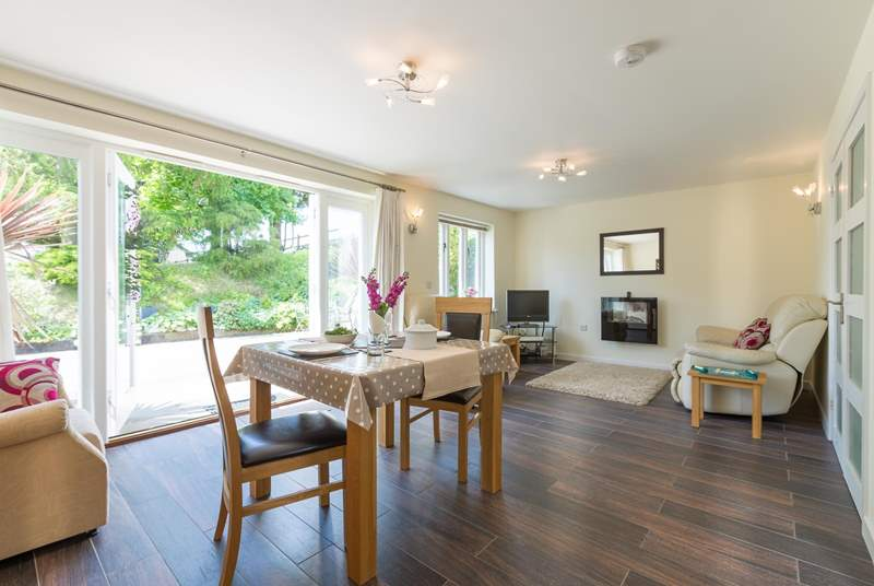 There is a light-filled, open plan living/dining-area with French windows to the sunny patio.