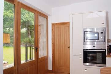 The enclosed private garden is accessed through the kitchen.