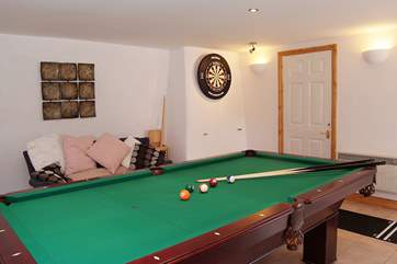 The games-room offers pool, snooker and darts - as well as a bar!