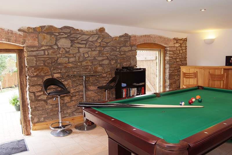 Snooker and pool are on offer here in this comfortable room.