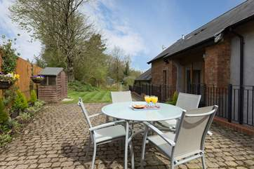 There is a very sunny and sheltered patio and lawned garden area behind the barn, with direct access into it on the level.