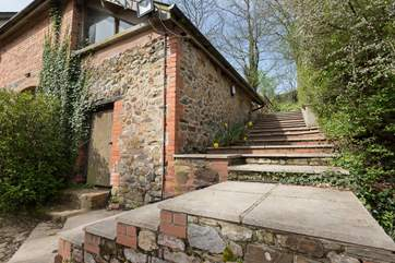 The stone steps up the side of the barn lead to your enclosed garden. A useful option but do take care as the steps can be slippery if wet. They are shallow and wide but there is no handrail.