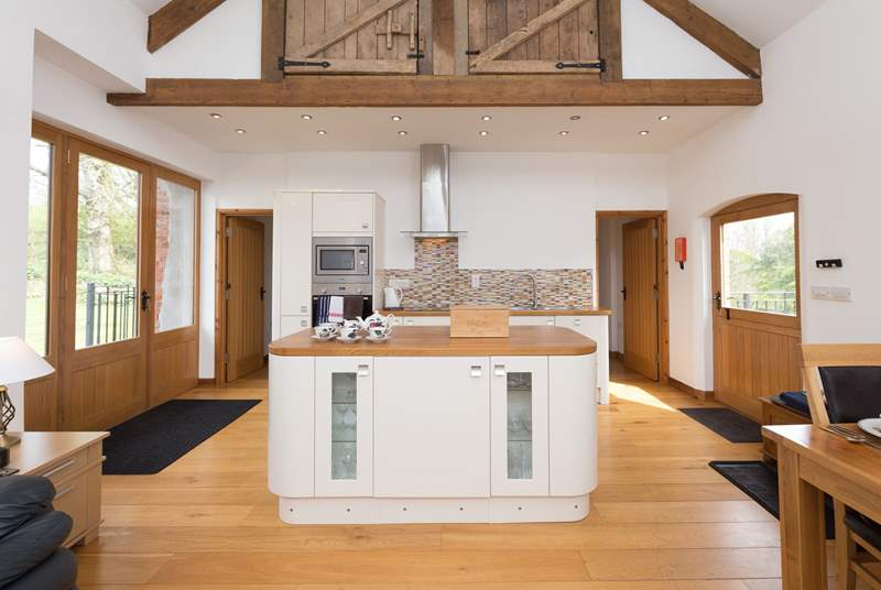 The stunning open plan living accommodation is double height, with access to the level private garden at the back of the barn