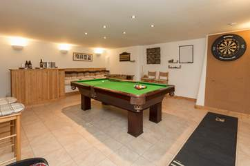 On the ground floor there is a wonderful games room for guests to enjoy. There is even a little honesty bar ! The utility room is next door to this games room.