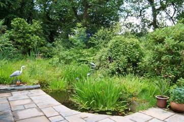The patio-area and garden with pond. Please take care with children.