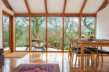The floor to ceiling windows really let the light in and take full advantage of the views of the garden.