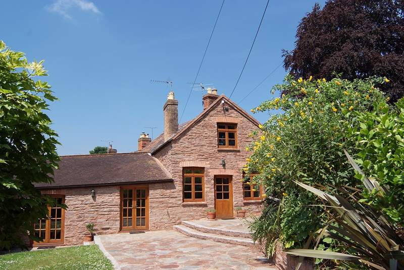 Court Cottage has a large enclosed garden, secure off road parking and a sunny stone terrace with direct access to both the living room and the kitchen.