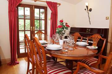An extra treat is a separate dining-room - with piano.
