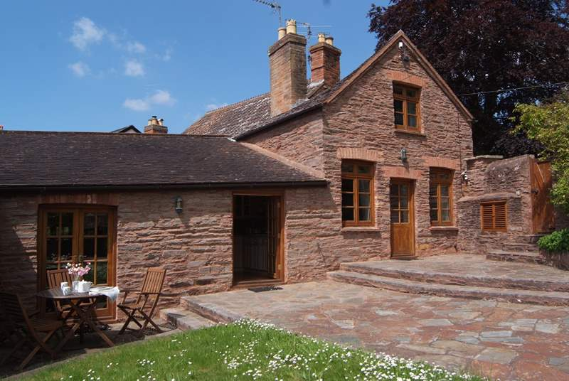 Court Cottage has a fully enclosed garden and patio with two sets of French windows to make the most of the lovely setting.