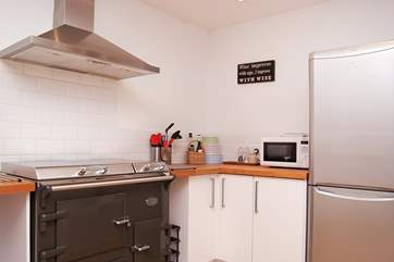 The kitchen-area is modern and well-equipped.