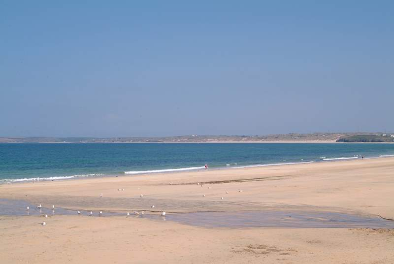 On its journey between Hayle and St Ives the little seaside train stops at spectacular Carbis Bay.