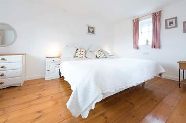 The master bedroom boasts a 6' bed.