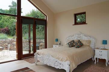 The bedroom suite is stunning and the views from the bed are of the patio and garden.