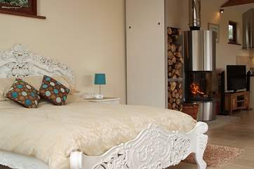 From the beautiful bed the open plan apartment is very cosy and relaxing.