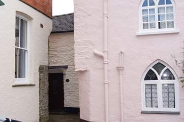 The black is the front of Lane Cottage - the key safe and back door are around to the left down the passage.