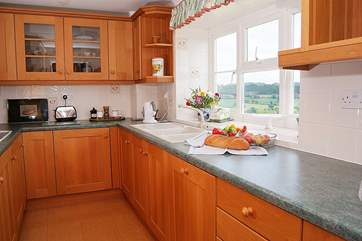 The galley-style kitchen is really well-equipped -making this a real home-from-home cottage.