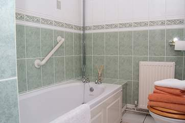 The bathroom lies off the ground floor hall and has a bath and separate shower.