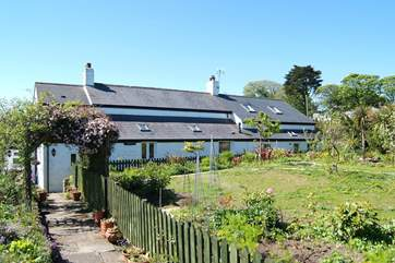 Trelyn (on the right) is a self-contained annexe attached to the Owners' home, which has a beautifully planted garden.