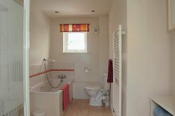 The bathroom is on the ground floor next to the twin bedroom. The bathroom has a separate shower cubicle as well as a bath.