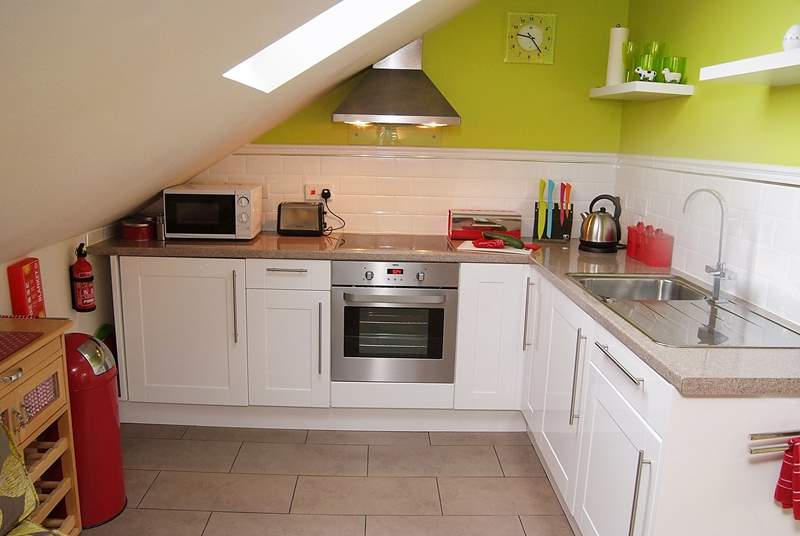 The compact but well-equipped kitchen area has a sloping ceiling - so please mind your head if you're tall!