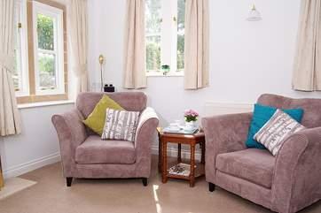 Sunlight fills the dual aspect sitting-room.
