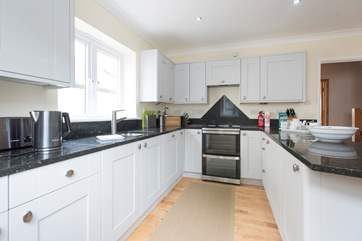 Well-equipped and spacious, the bright and airy kitchen.