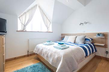 Bedroom 1 with double bed (5'), TV and en suite Shower-room with shower, WC and wash-basin,  and office.