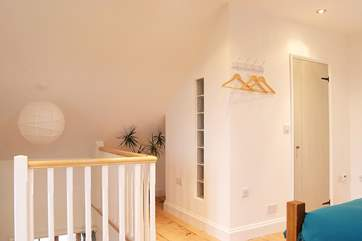 Stairs lead up to the galleried bedroom with the shower-room on the right-hand side.
