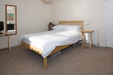 The master bedroom houses a double bed.