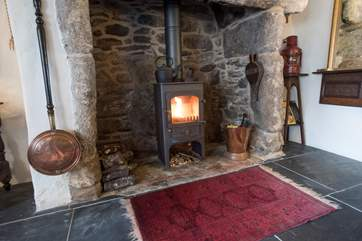 The roaring wood-burner in the sitting-room.