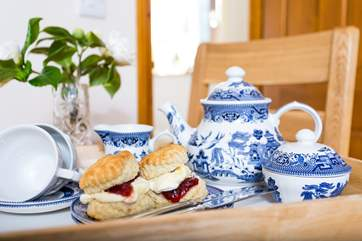 A delicious cream tea awaits you.