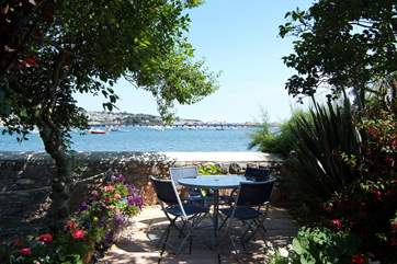 The sheltered, sunny waterfront garden with views of the estuary is across the lane from the cottage