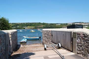 The slipway just past the front door; the cottage has enough parking for a dinghy or small boat trailer.