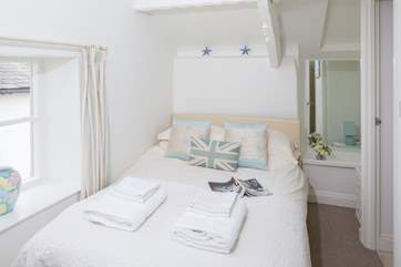 Bedroom 2 is at the front of the cottage and has an en suite shower and wash-basin.