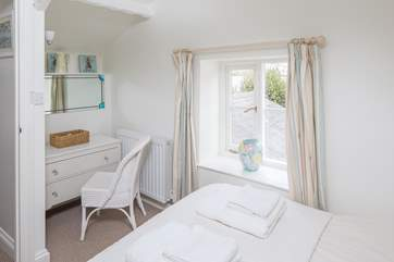 Bedroom 2 has views over the estuary.
