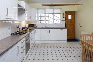 Spacious kitchen, which leads out to the terraced garden at the rear.