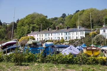 Looking back to Chindit Cottage from the side-walk along the river Dart.