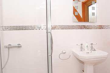 The excellent sized en suite is bright and contemporary.