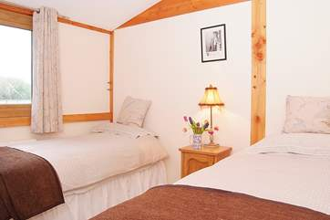 The twin room offers plenty of space for adults as well as children.