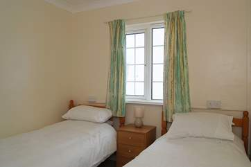The ground floor twin room (Bedroom 2) is also behind the sitting-room, next to Bedroom 1.