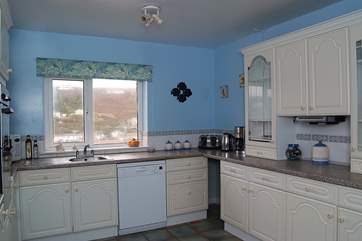 The kitchen is bright and well-equipped.