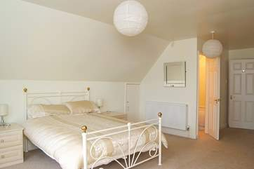 Extremely spacious Bedroom 3 has an en suite bathroom.