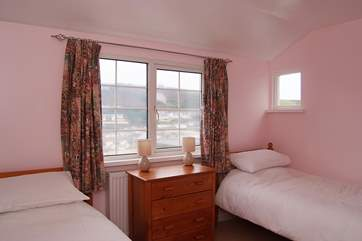 Also upstairs, Bedroom 4 has twin beds and lovely views down to the beach.